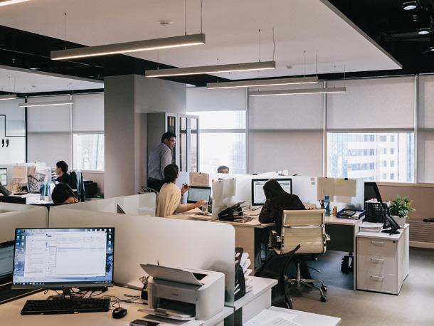 People in an open-plan office.